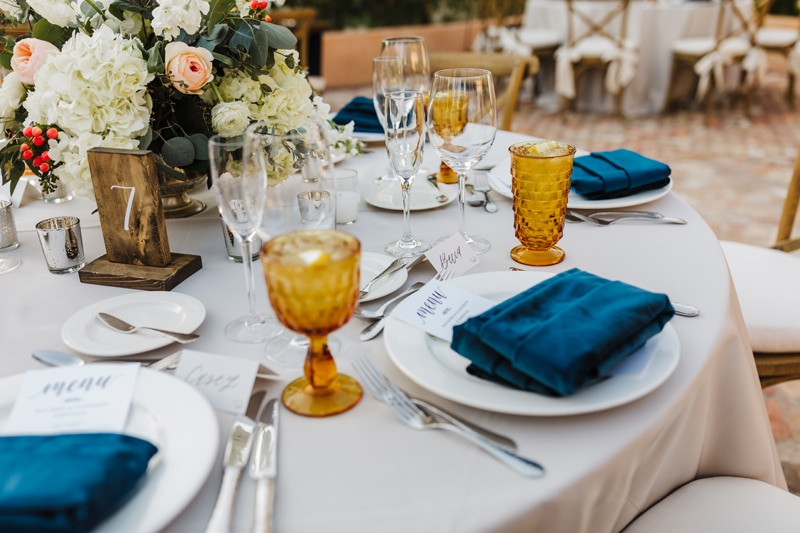 Wedding photographer, a table is set with formal settings for a banquet